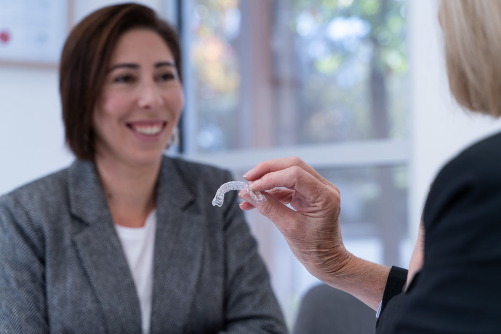 orthodontic consultation showing Invisalign clear aligner