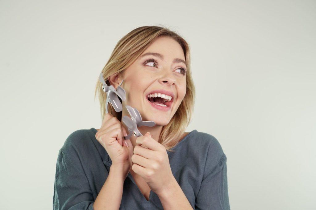 girl using dental monitoring cheek retractor tool