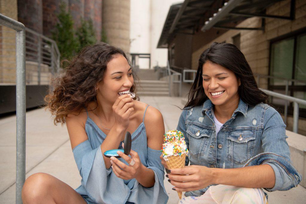 Girls with Invisalign eating ice cream
