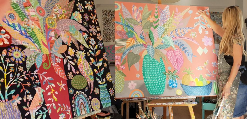 Eliza Piro painting in her studio