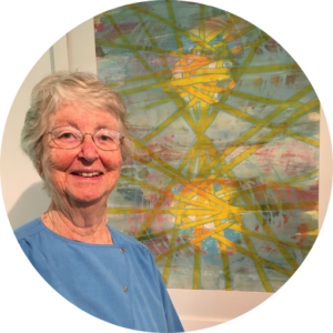 Photo of Anne Johnson in front of her painting